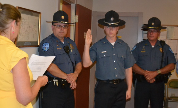 New part-time officer in training, Austin Biery, takes oath.