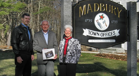 Author of a childrens book on Madbury, Nancy Bergeron, with the Selectmen.