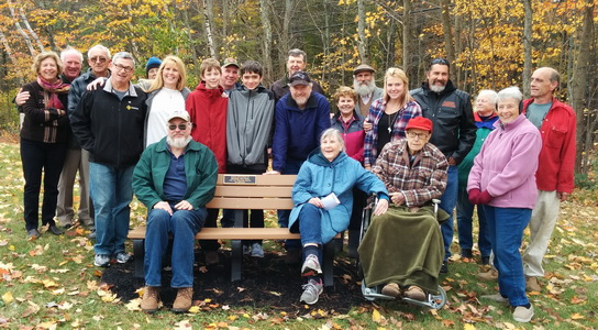 A bench at Tibbetts Field is dedicated to George Mattson (red hat) for his long volunteer servcie to the town.